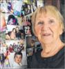Diese Fotowand mit Bildern von Kindern, die Bärbel Herre betreut hat und die ihr ans Herz gewachsen sind, hat einen Ehrenplatz im Wohnzimmer der Familie.